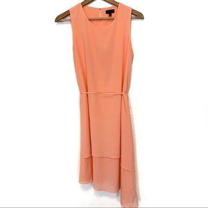The limited sleeveless asymmetrical midi dress